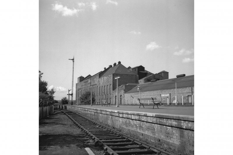 Kirkcaldy, Station Road, Caledonia Linoleum Works View from NE showing part of station platform with S blocks of linoleum works in background