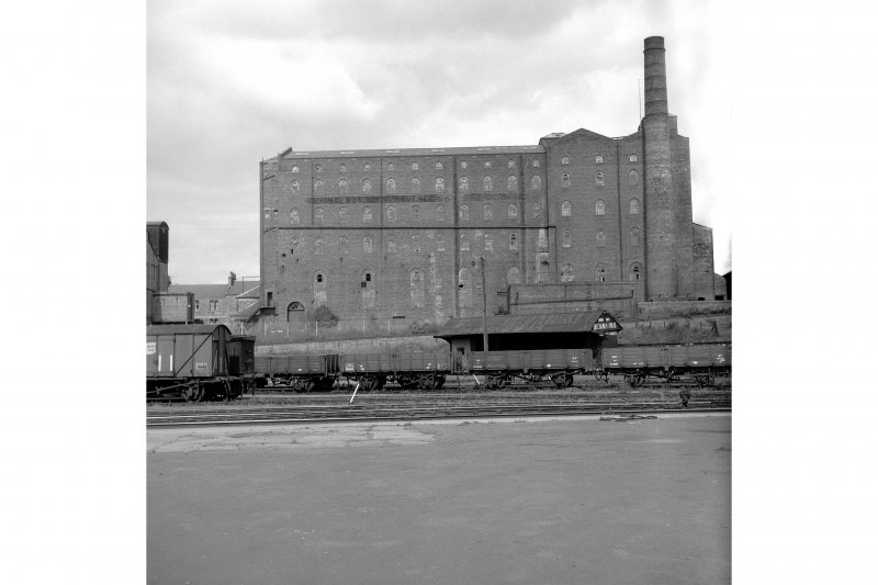 Kirkcaldy, Bennochy Road, Walton Linoleum Factory View from SE showing SE front of linoleum works with trucks and coal merchant building in foreground
