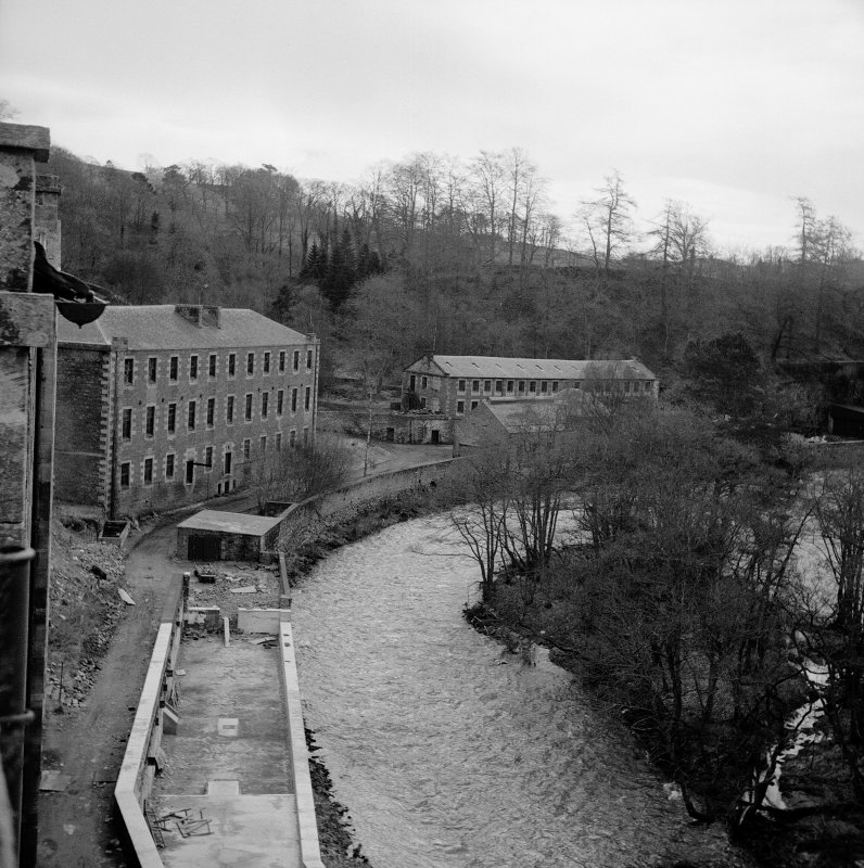 New Lanark View from N showing W face of school; in background are the Engineer's shop and the Dye Works/Foundry