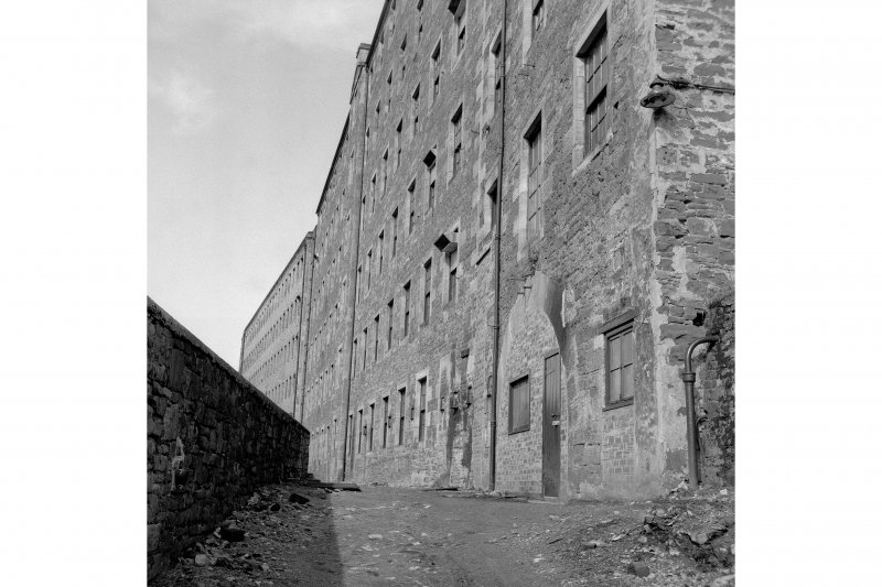 New Lanark View of rear of Mill No. 3 (foreground) and Mill No. 2 (background), from SE; note wheel arch in foreground