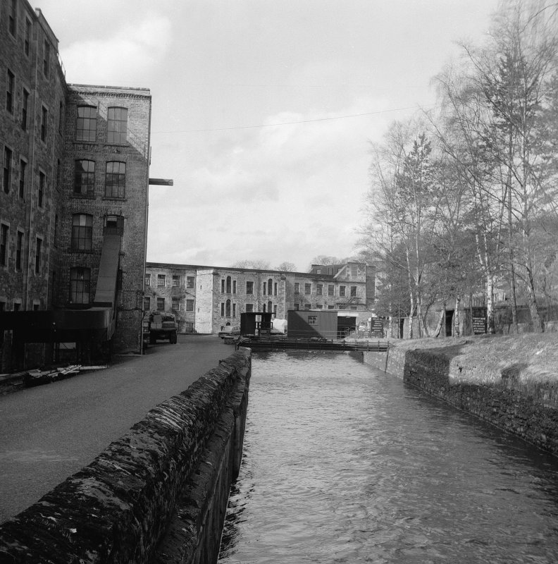 New Lanark, Lade View from SE along main stretch of lade, Mill No.1 in background