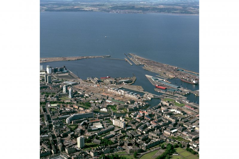 Scanned image of colour photograph, oblique aerial view, taken from the SSE, centred on Leith Docks with North Leith in the bottom half.