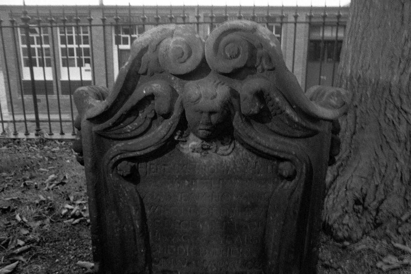 North Leith Burial Ground. View of gravestone, Hall and Horn, volutes and lillies top, soul centre with drape and inscription.
