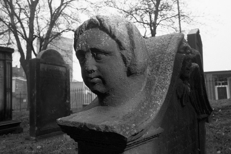 North Leith Burial Ground. View of gravestone, James Home, face on shoulder of stone.
