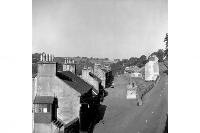 New Lanark, 3 Rosedale Street, Robert Owen's House View looking WNW showing ESE and NNE fronts of number 3 with Long Row and numbers 5-127 Rosedale Street in background