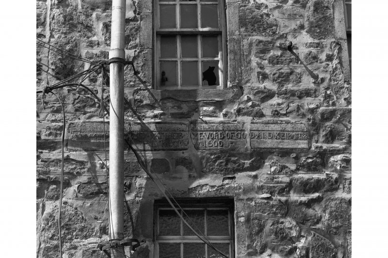 Edinburgh, Quayside Street, Quayside Mills, St. Ninian's Church and Manse. View of inscribed lintel stone built into East wall of manse extension. Insc: 'Blessed Are They Yat Heir Ye Vord Of God And Keip It...Luke....1600'.