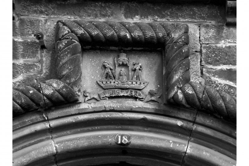 Edinburgh, 12-14 John's Place. Detail of crest and rope moulding above entrance to warehouse in South-West wall.