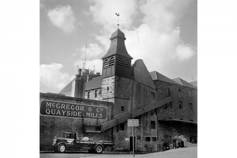 Edinburgh, Quayside Street, Quayside Mills. General view with a truck underneath the long loading chute.
