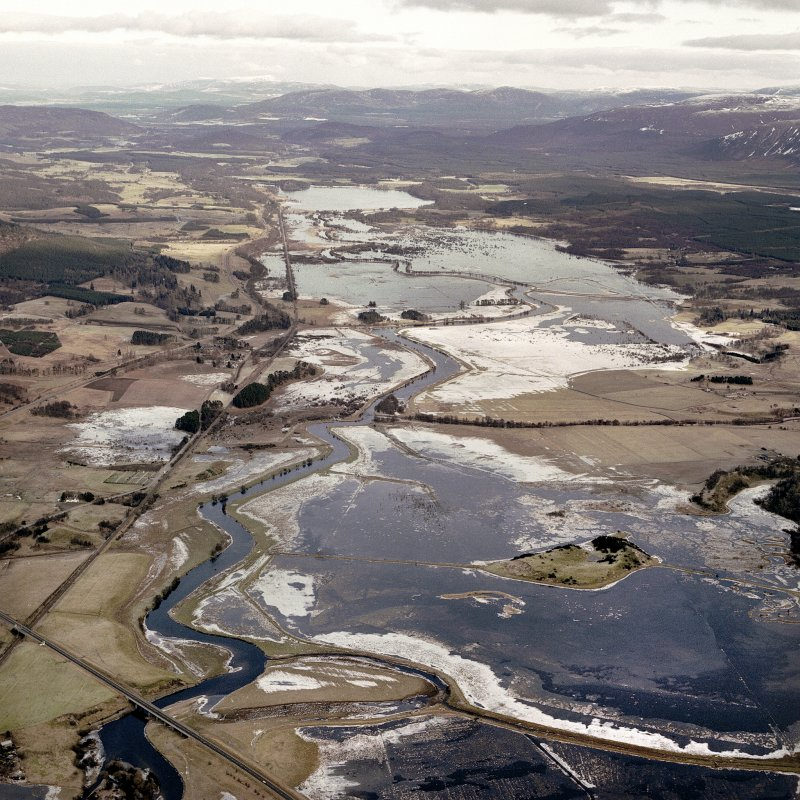 Oblique aerial view of Strathspey under flood water and snow, taken from the South South West.