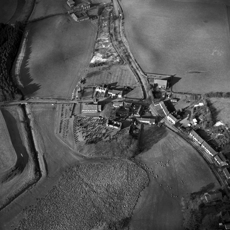 Dalton, oblique aerial view, taken from the SE, centred on the old parish church and the parish church. A road bridge is visible in the centre left-hand side of the photograph.