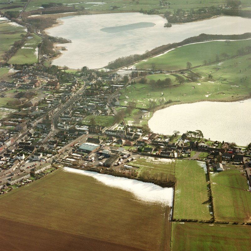Lochmaben, oblique aerial view, taken from the NW, centred on the S part of the town, with St Mary Magdalene's church and burial ground and Lochmaben old castle and motte visible in the centre of the photograph.