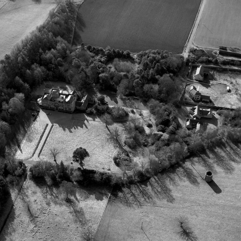 Wallhouse, oblique aerial view, taken from the NE, centred on the country house. A dovecot is visible in the bottom right-hand corner of the photograph.