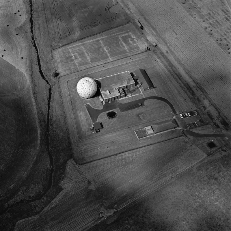 Scanned image of oblique aerial view showing Bridge, SATCOM III satellite tracking station and part of the WW II Airfield taken from the ESE, centred on the tracking station.