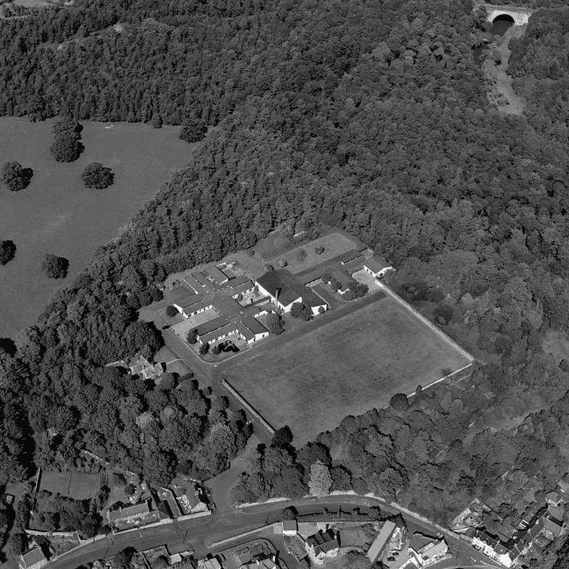 Dalkeith, Lugton Brae, oblique aerial view, taken from the SW, centred on school buildings. Montagu Bridge is visible in the top right-hand corner of the photograph.