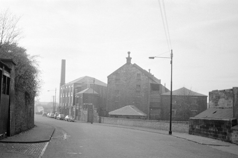 Glasgow, 206 Old Dumbarton Road, Bishop Mill View from SE showing SE front of mill with Artizan Machine Tool Works in background and remains of warehouse in right foreground