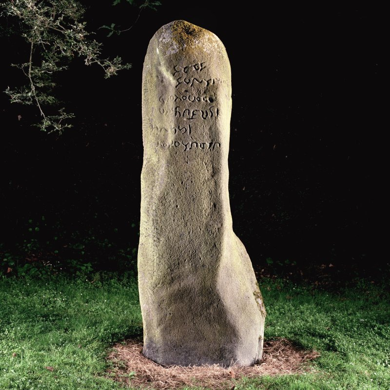 View of ogham inscribed stone (flash-lighting).