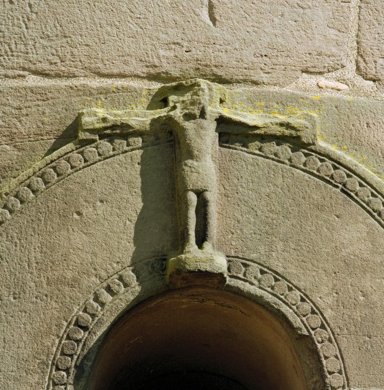Detail of carved crucifix above doorway on West side of tower.