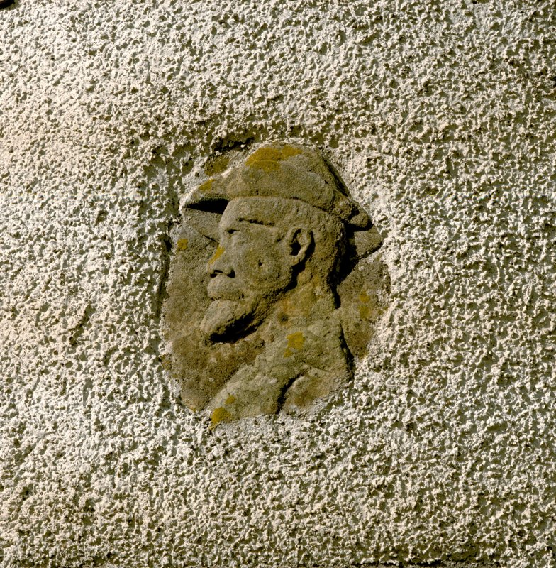 Leith Hall, exterior.  East entrance block: detail of carved head on turret at North East corner