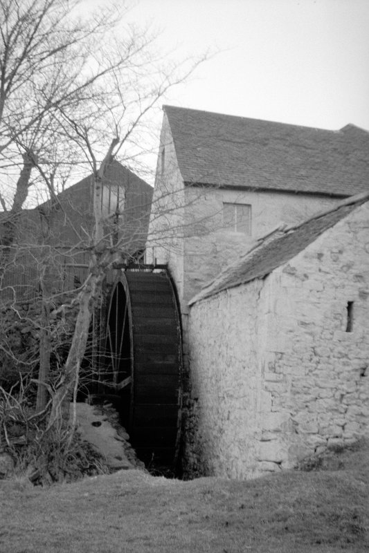 View from SE showing waterwheel and part of mill