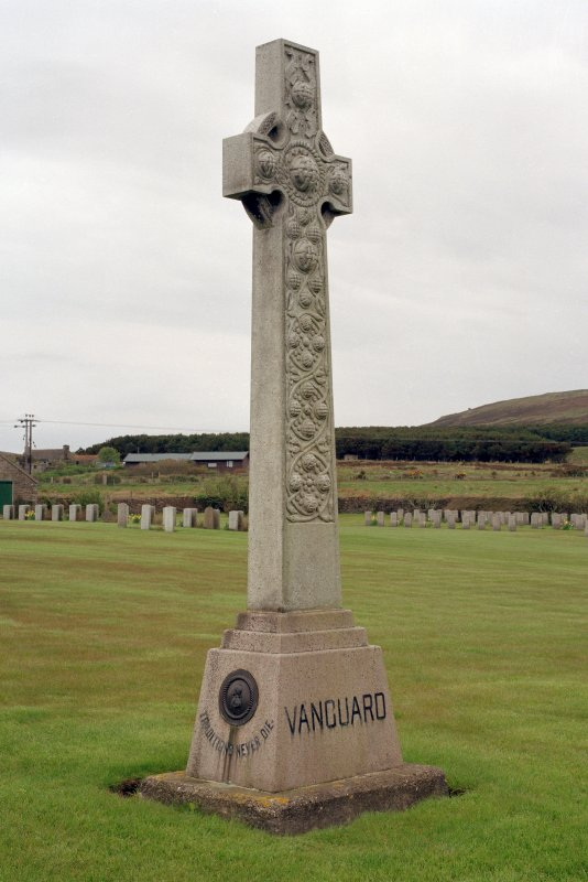 The Memorial to HMS Vanguard, World War I and II Naval Cemetery, Lyness, Hoy, Orkney Islands  This memorial to the officers and men of HMS Vanguard takes the form of a ringed and interlaced Celtic high cross. The inscription on the base reads: Traditions Never Die. HMS Vanguard, a 19,560-ton battleship blew up at anchor off the Calf of Flotta on 9 July 1917 with the loss of over 1,000 men, that is, of all but two of her company.   View from North East
