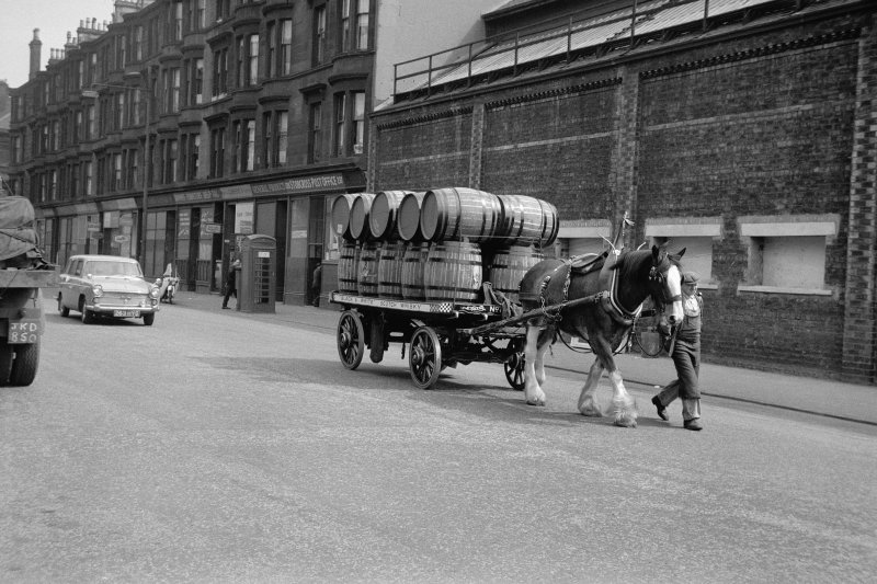 View from WNW showing horse lorry travelling along Stobcross Street with tenements and works in background