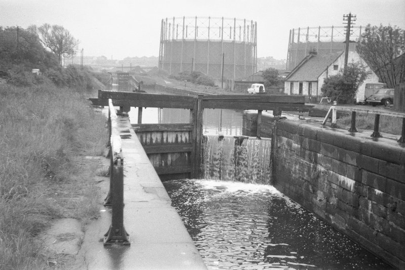 View from NW showing WNW front of E lock gates with gasholders and lock-keeper's cottage in background
