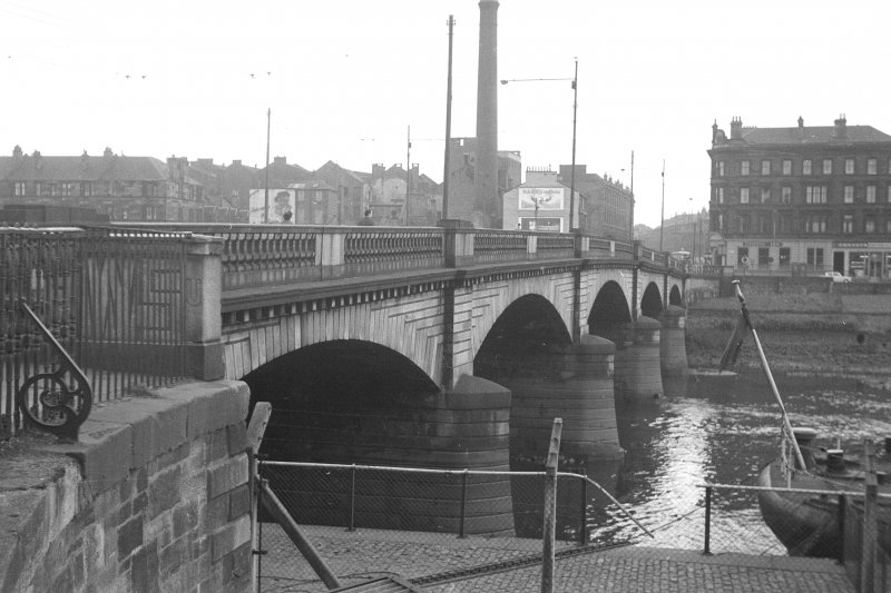 View from NNE showing WNW front of bridge with tenement and distillery in background