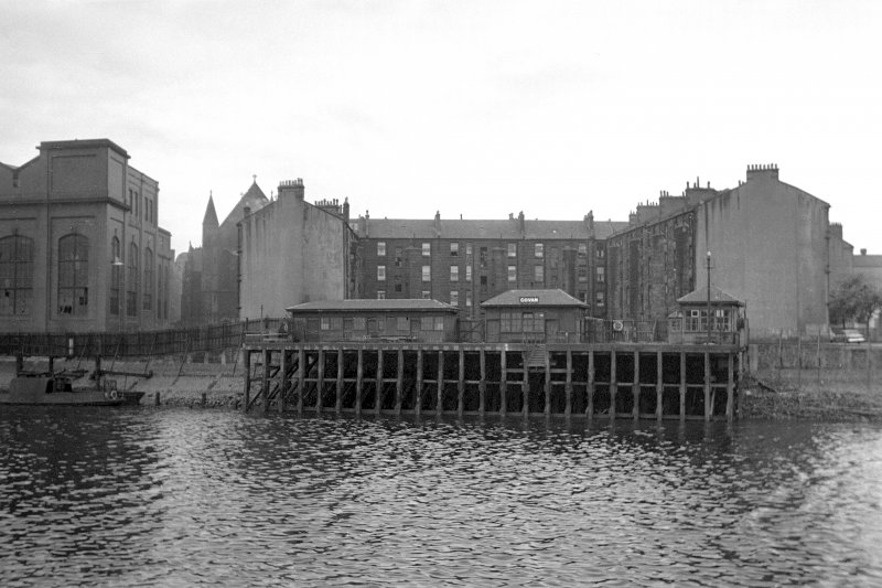 View from NE showing NE front of pier with tenements and part of platers shed in background
