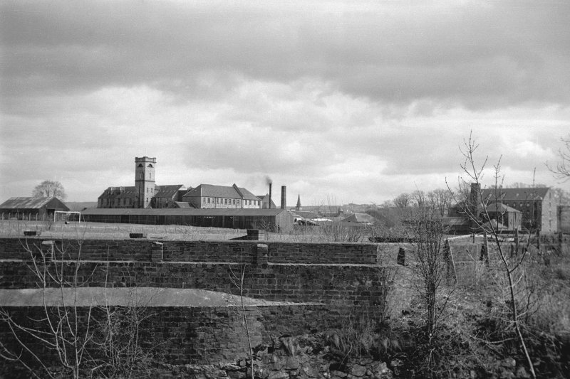 Distant view from WNW showing Viewfield Cabinet Works on left and Calderhaugh Silk Mill on right