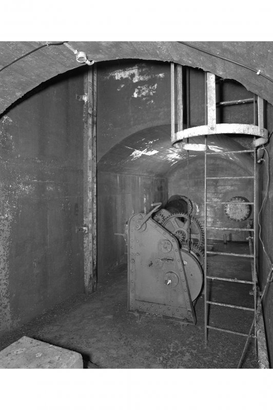 Tank access tunnel, detail of float gauge, winch and access ladder.