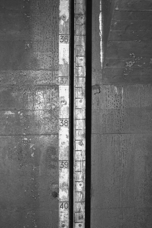 Tank access tunnel, detail of float gauge scale.