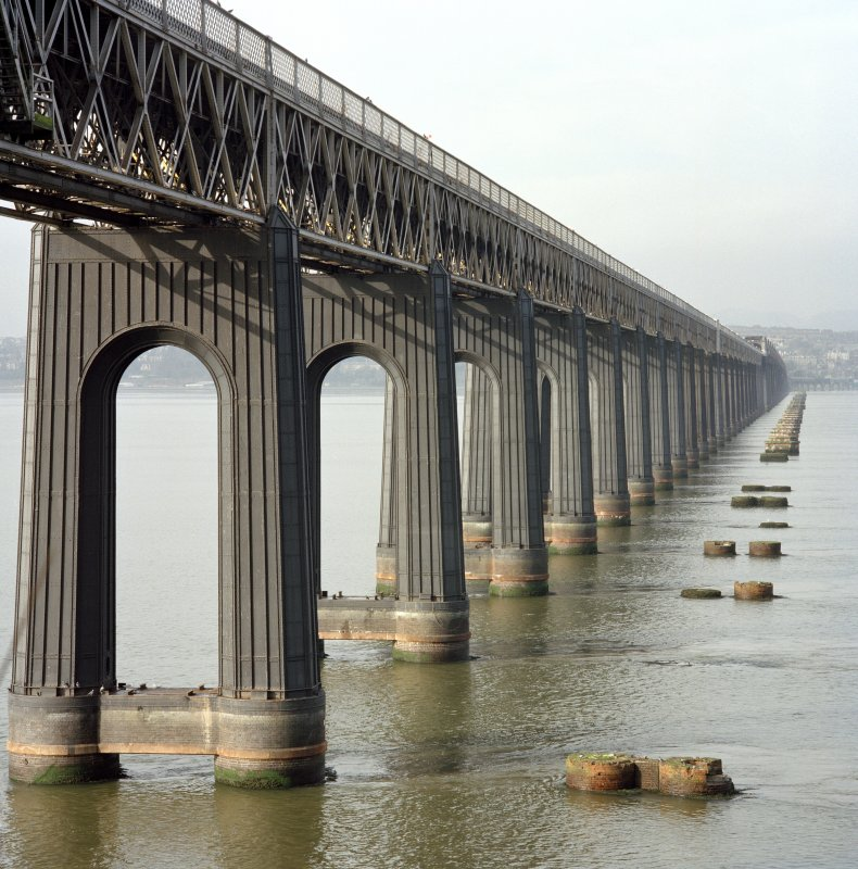 Detailed view of the Tay Railway Bridge, Dundee, from SE of the steel piers and girders forming the south end of the bridge, with the foundations of the earlier bridge visible (right).