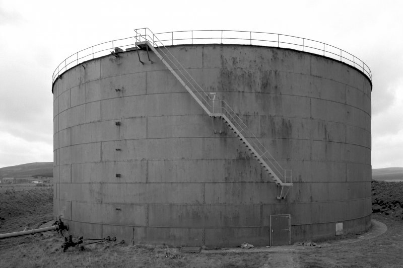 View of circular oil storage tank from East