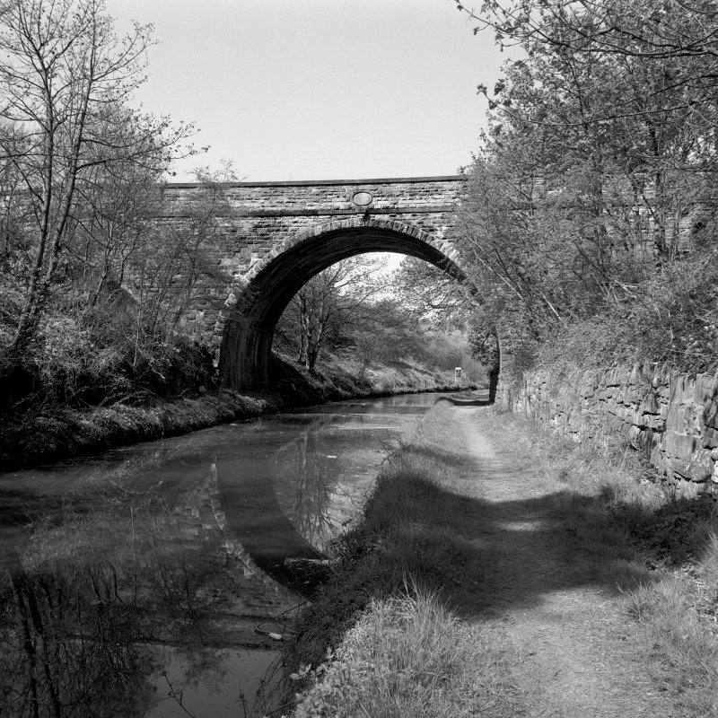 View from towpath to ESE Glen Village, Union Canal bridge no.61. Digital image of E5869.