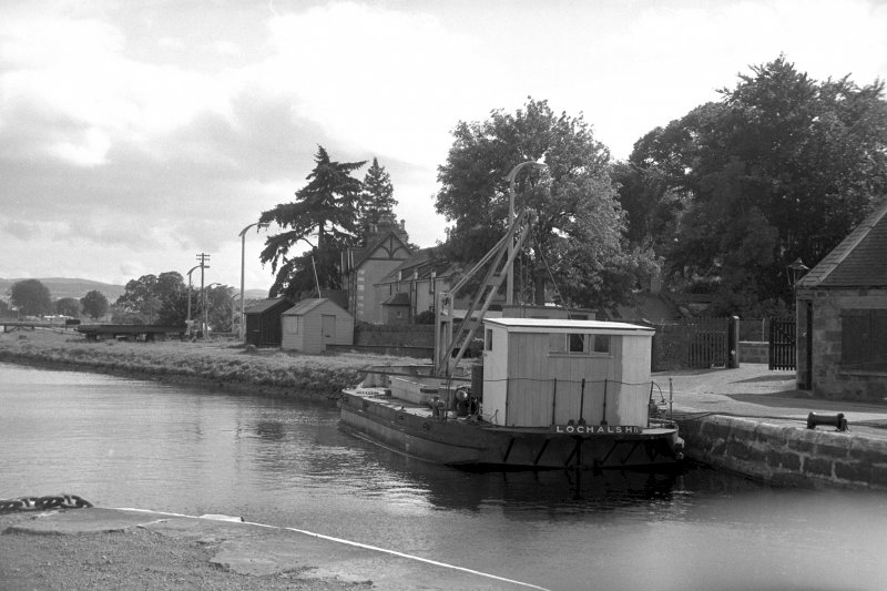 View from NNW showing workboat at N end of Muirtown Basin with part of smithy on right