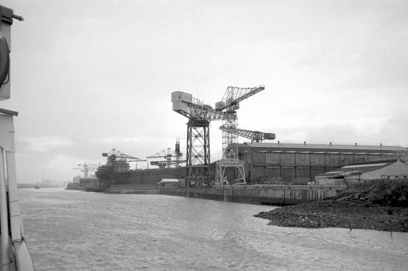 View from SE showing River Clyde front of North British Diesel Engine Works with Scotstoun Shipyard in background
