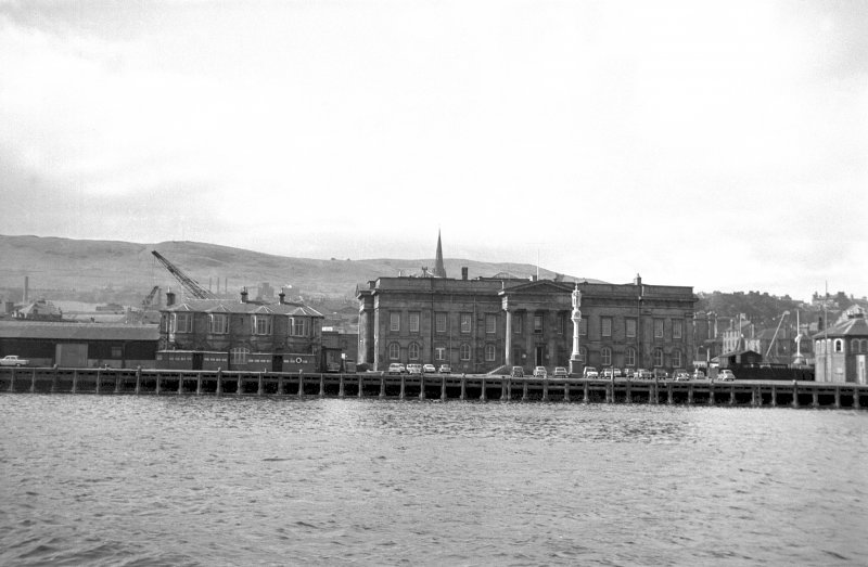 View from NE showing NE front of Custom House with Steamboat Quay in foreground
