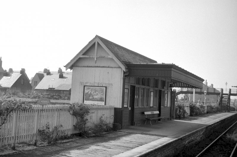 View from NNE showing NE and NW fronts of up platform building with wood footbridge in background