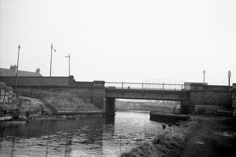 View from NW showing NW front of bridge with locks in background
