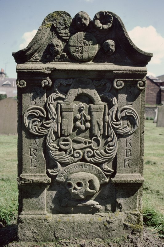 Perth, Greyfriars Burial Ground. Reverse face of gravestone, trade emblems of the Perth Glovers.
