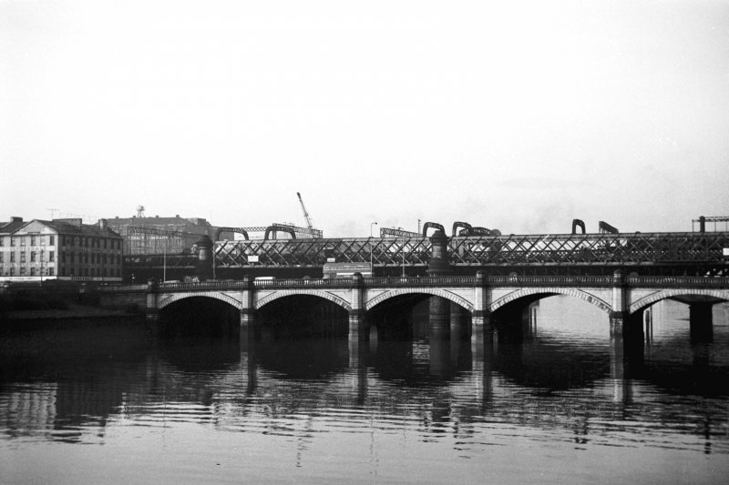 View from E showing part of ESE front of Glasgow Bridge with railway bridge in background