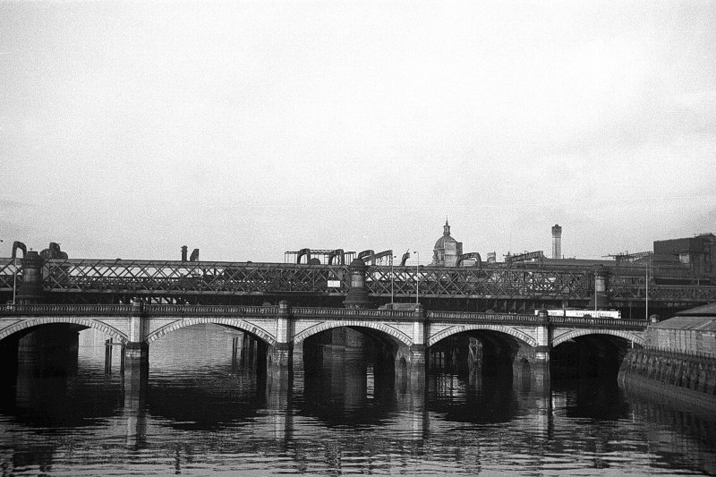 View from ESE showing part of ESE front of Glasgow Bridge with railway bridge in background