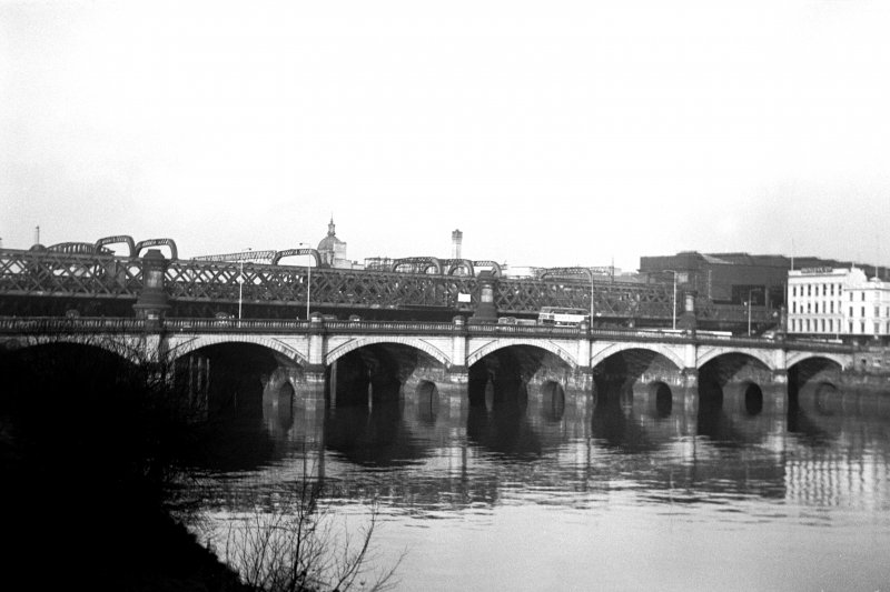 View from SE showing part of ESE front of Glasgow Bridge with railway bridge in background