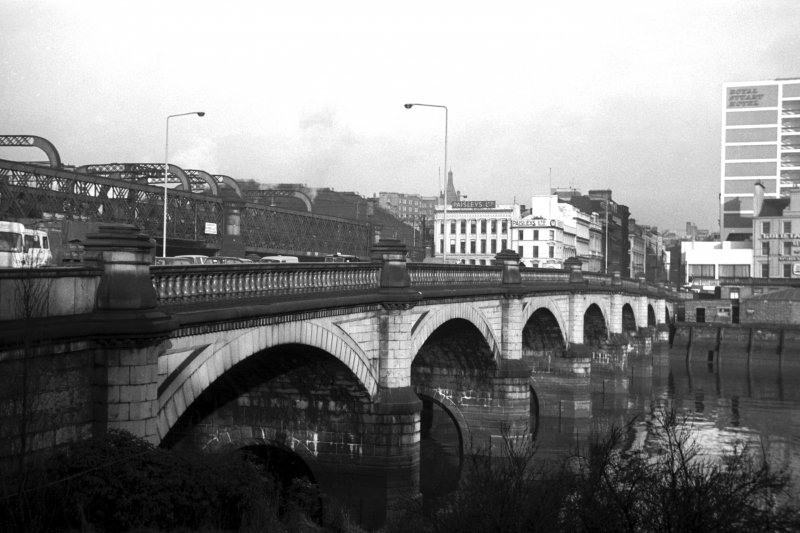 View from S showing ESE front of Glasgow Bridge with railway bridge on left