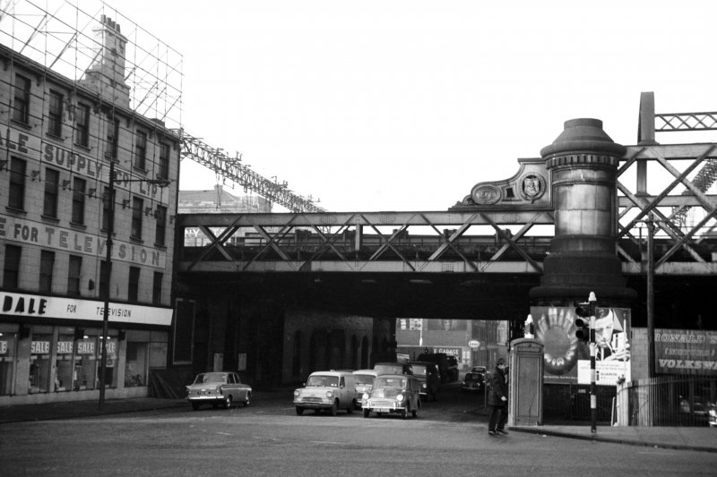 View from E showing ESE front of S span of railway bridge with part of shop on left