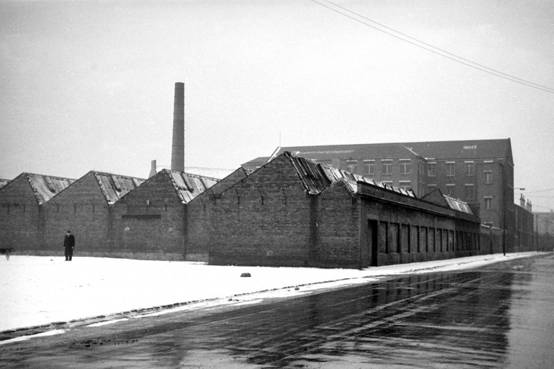 View from E showing NNE front and part of ESE front of weaving sheds with central block in background