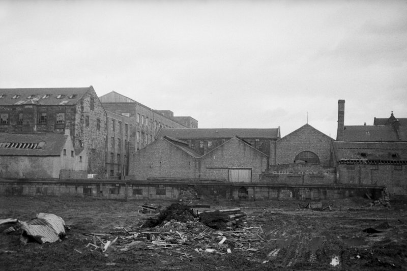 View from W showing WNW front of engineering works with part of foundry on right and mill on left