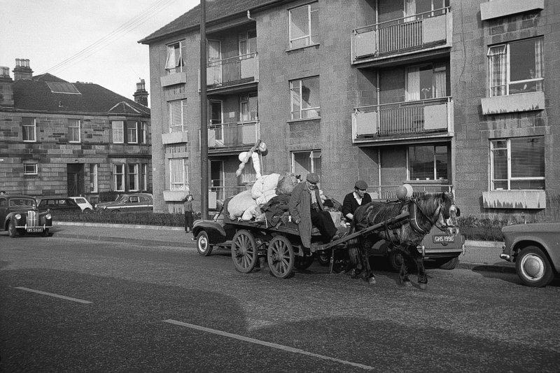 View from WSW showing horse cart passing number 700 Crow Road with number 1 Sackville Avenue in background