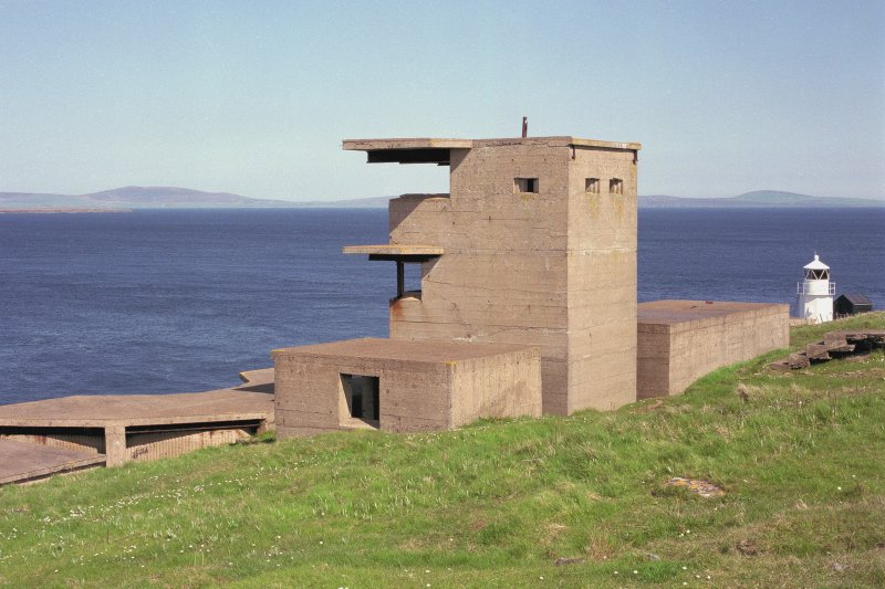 Scanned image of Battery Observation posts (towers) for  W.W.2 twin 6-pounder gun emplacements, view from South East.  Light beacon in the background.