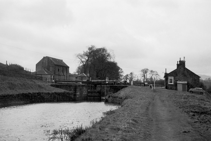 View from ENE showing ESE front of lock with cottage on right and bothy and hostelry in background